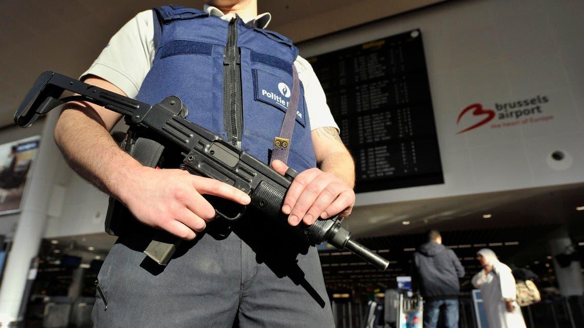 Belgium police arrest three in raid (Reuters)