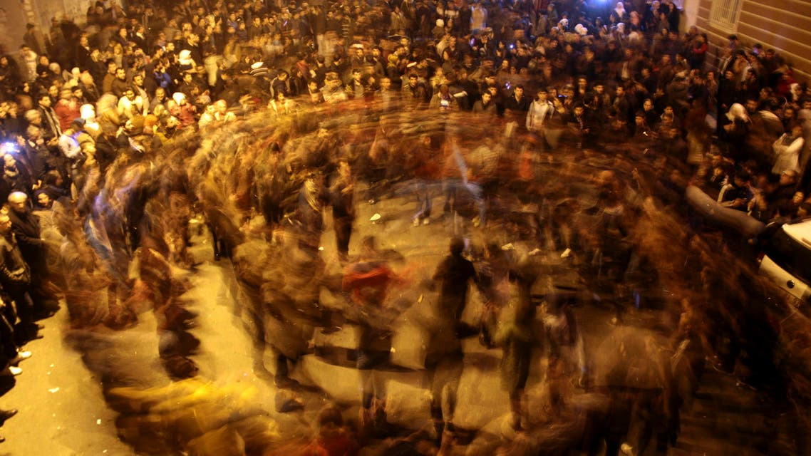 People dance as they celebrate in Kurdish-dominated Diyarbakir in southeastern Turkey, after Kurdish forces took full control of the Syrian town of Kobane, January 26, 2015. (Reuters)