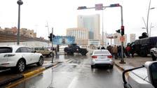 Gunmen blow themselves up inside Tripoli hotel