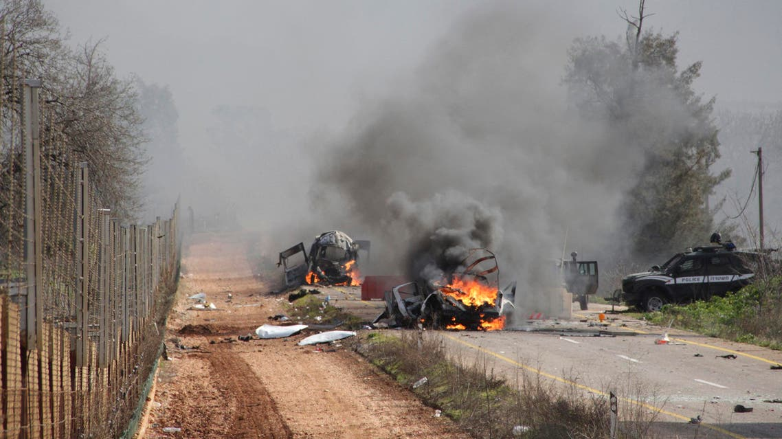 Burning vehicles are seen near the village of Ghajar on Israel's border with Lebanon Jan. 28, 2015. (Reuters)