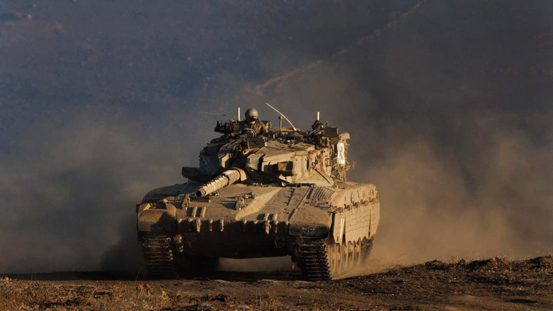 An Israeli tank maneuvers during a drill in the Golan Heights, near the border between the Israeli-controlled Golan Heights and Syria. (File photo: AP)