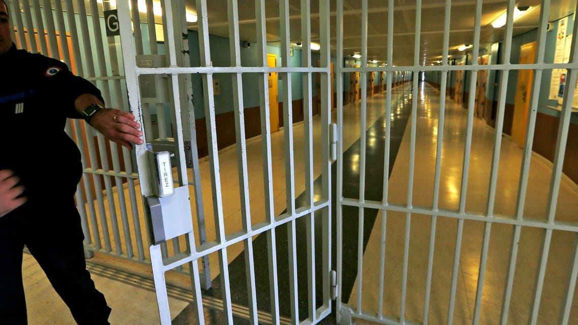 A warder closes the gate inside the men's building at the Fleury-Merogis prison, near Paris, in this May 14, 2014 file picture. (Reuters)
