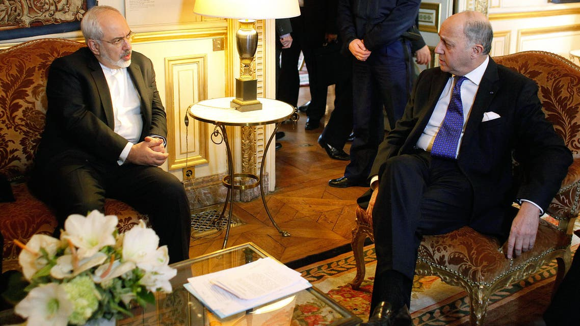 French Foreign Minister Laurent Fabius, right, talks with his Iranian counterpart Mohammad Javad Zarif during a meeting at the Quai d'Orsay, in Paris, Friday, Jan. 16, 2015. AP