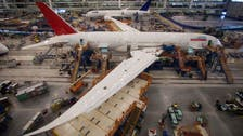 Boeing earnings rise on record commercial deliveries