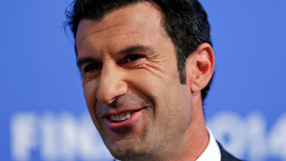 Champions League final ambassador Luis Figo smiles during the draw for the Champions League semi-finals matches at the UEFA headquarters in Nyon, in this April 11, 2014 file photo. (Reuters)