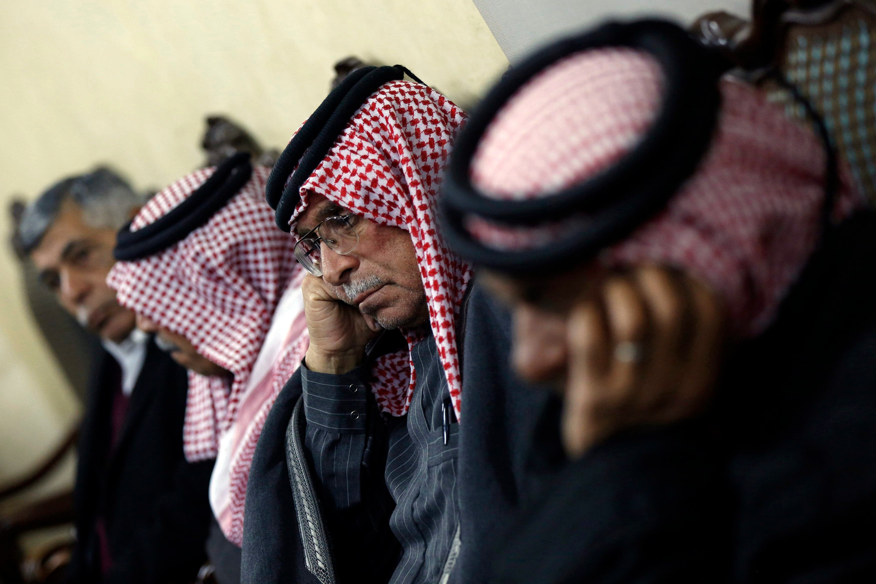Safi Yousef (2nd R), father of captive Jordanian pilot Muath al-Kasaesbeh, listens to a statement released by ISIS, at his clan's headquarters in Amman Jan. 28, 2015. (Reuters)