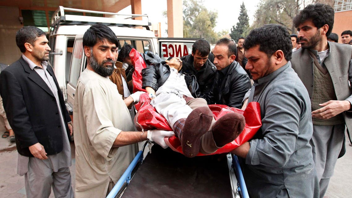 Afghan men carry a wounded man at a hospital in Jalalabad, after a suicide attack which targeted funeral prayers in Laghman province, January 29, 2015. (Reuters)