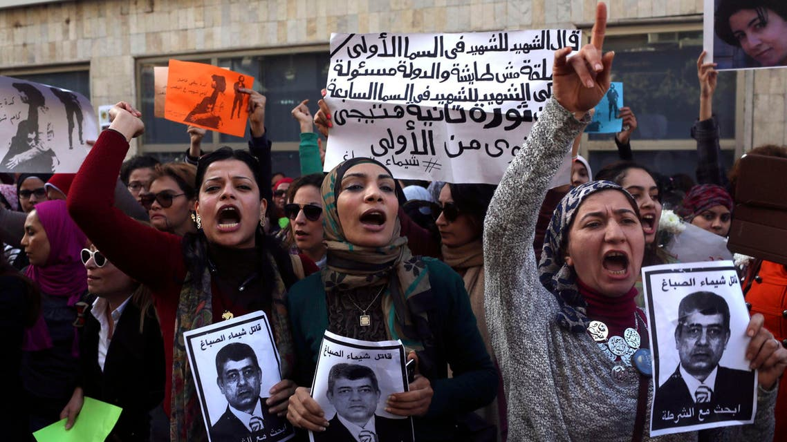 """Protesters chant anti-government slogans while holding posters of Egyptian Interior Minister Mohamed Ibrahim with the words, """"Wanted, the killer of Shaimaa al-Sabbagh"""" (Reuters)"""