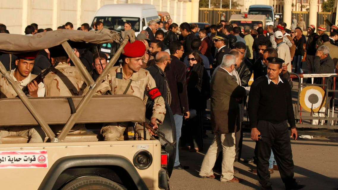 A convoy of army soldiers arrive to secure the funerals of security personnel killed in the Sinai city of al-Arish in front of Almaza military air-base where the funerals were held in Cairo Jan. 30, 2015.  (Reuters)