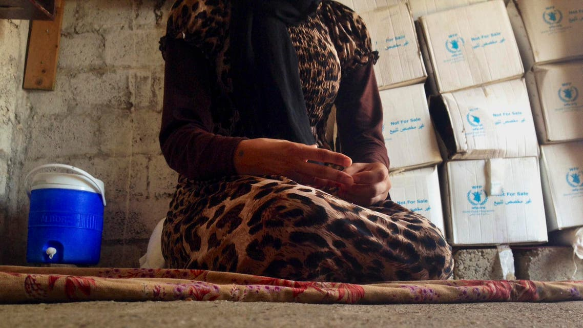 In this file photo taken Wednesday, Oct. 8, 2014, a 15-year-old Yazidi girl captured by the Islamic State group and forcibly married to a militant in Syria sits on the floor of a one-room house she now shares with her family after escaping in early August, while speaking in an interview with The Associated Press in Maqluba, a hamlet near the Kurdish city of Dahuk, 260 miles (430 kilometers) northwest of Baghdad, Iraq. Hundreds of women have been captured by the group, enslaved and sold, many have been subjected to sexual violence and others have been stoned for adultery. (AP Photo/Dalton Bennett, File)