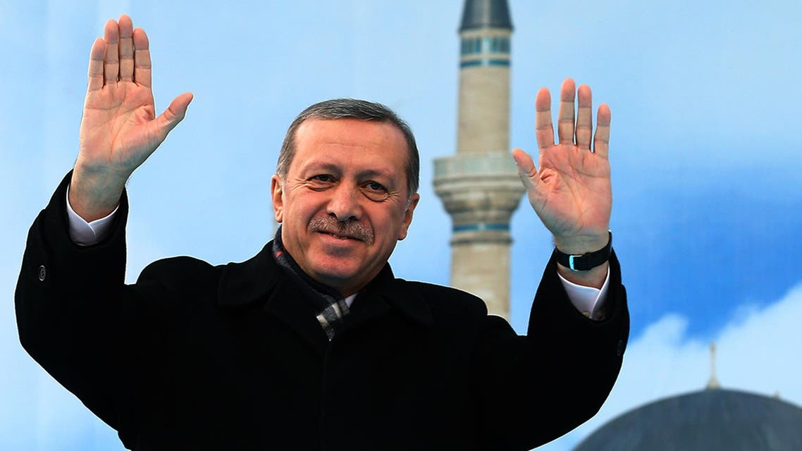 In this photo provided by the Presidential Press Service, Turkish President Recep Tayyip Erdogan salutes his supporters in Konya, Turkey, Wednesday, Dec. 17, 2014. AP