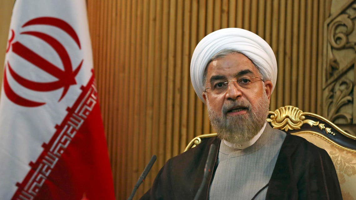 FLE - In this file photo taken Monday, Sept. 22, 2014, Iranian President Hassan Rouhani briefs media prior to departing Mehrabad airport to attend the United Nations General Assembly, in Tehran, Iran. AP