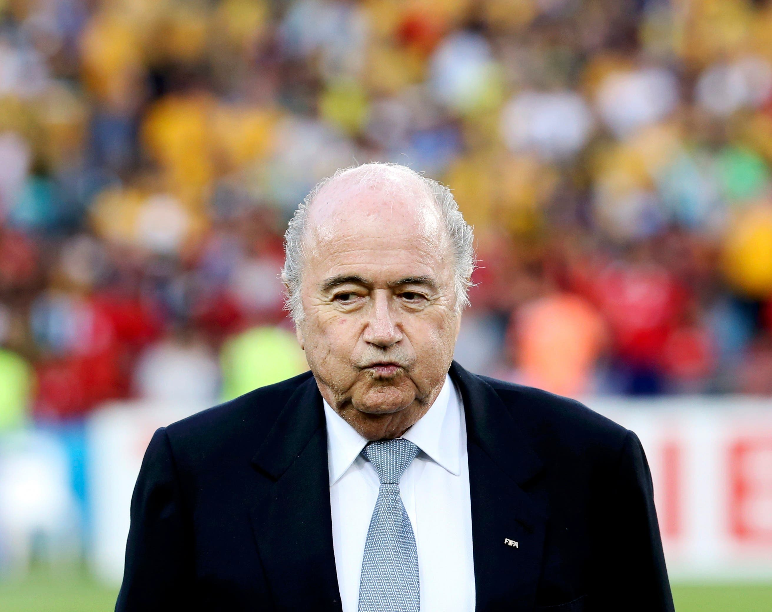 FIFA President Sepp Blatter reacts before the Asian Cup final soccer match between South Korea and Australia at the Stadium Australia in Sydney January 31, 2015. REUTERS