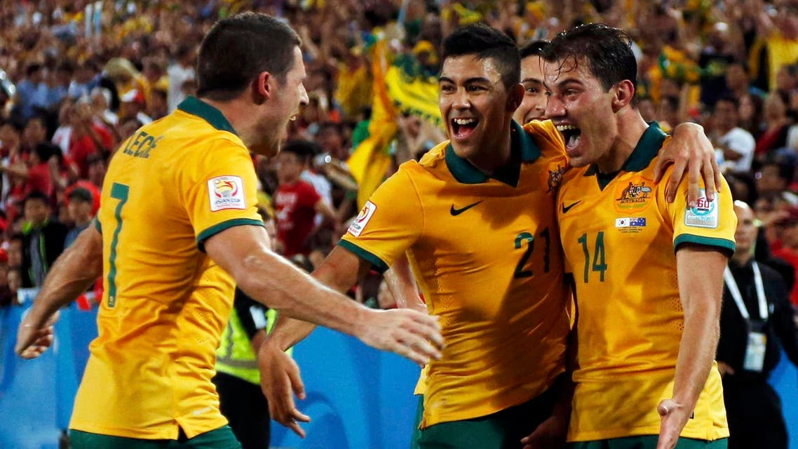 Australia's James Troisi (R) celebrates with teammates after scoring a goal against South Korea during extra time of their Asian Cup final soccer match at the Stadium Australia in Sydney January 31, 2015. (Reuters)