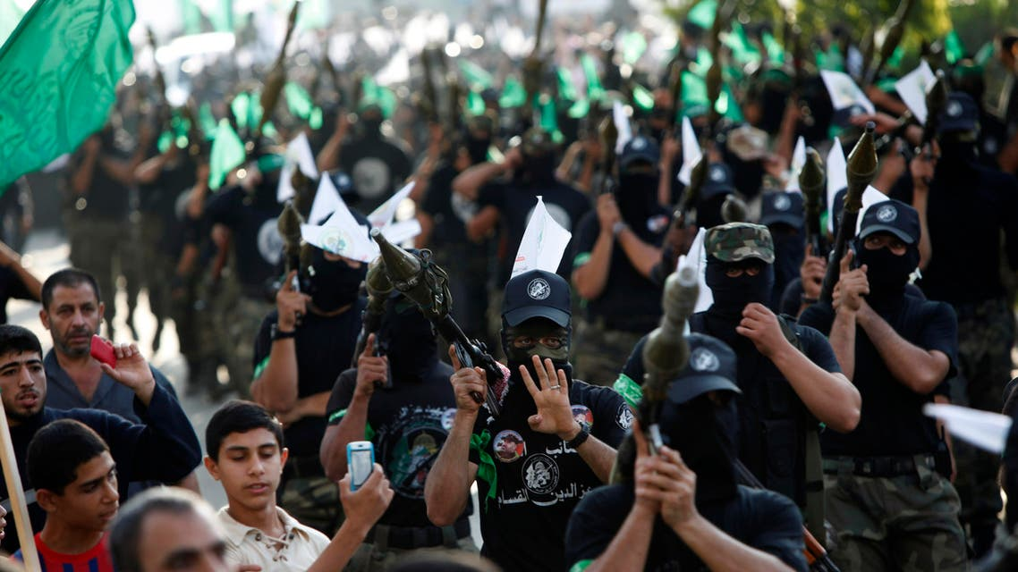 Masked Palestinian members of the Ezz Al-Din Al Qassam brigade, the military wing of Hamas, march with their weapons during a parade to mark the anniversary of a battle against Israel in Gaza City, Thursday, Nov. 14, 2013. (File photo: AP)