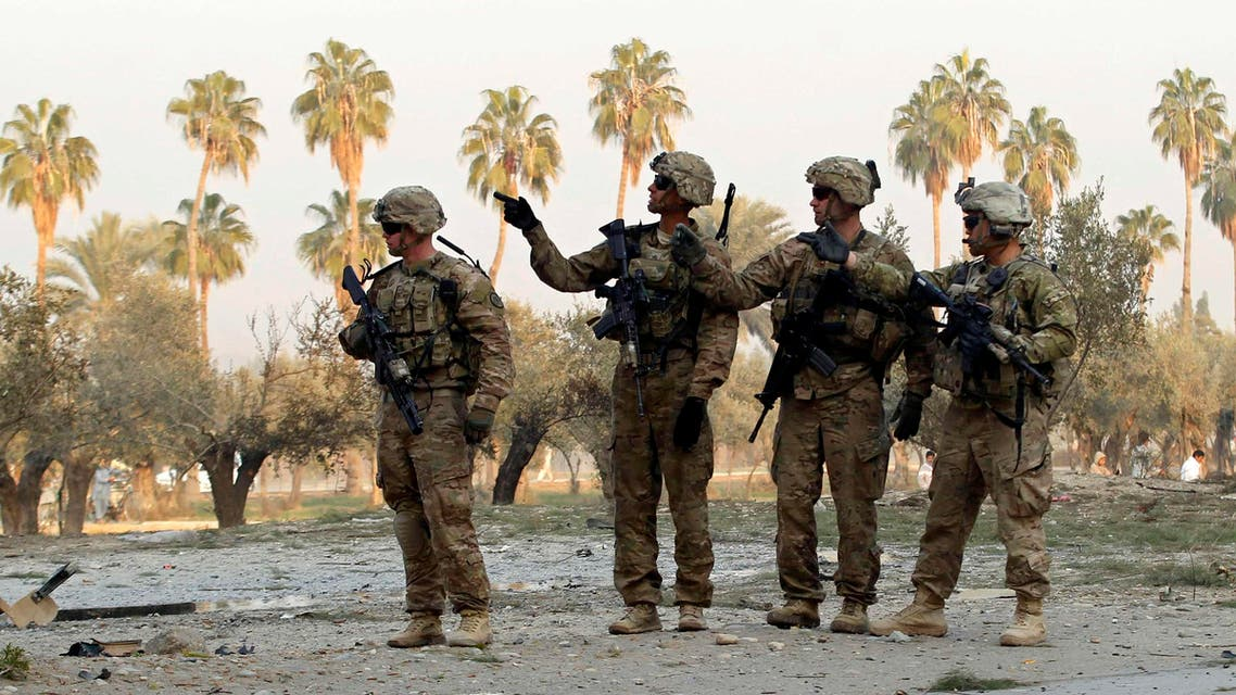 U.S. troops keep watch at the site of a suicide attack on the outskirts of Jalalabad, January 5, 2015. (Reuters)