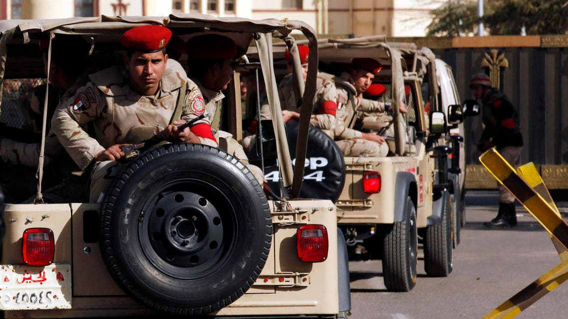 Soldiers in a convoy secure a military funeral ceremony of security personnel killed in attacks in Sinai, outside Almaza military airbase where the funerals were held, in Cairo, January 30, 2015. (File photo: Reuters)