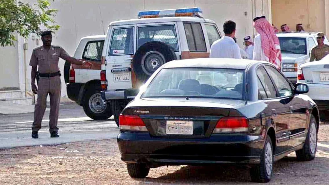 Saudi police officers check the site of the Khaleej neighborhood of eastern Riyadh, Saudi Arabia, Tuesday, June 8, 2004, where an American citizen was shot and killed. The victim worked for Vinnell Corp.,