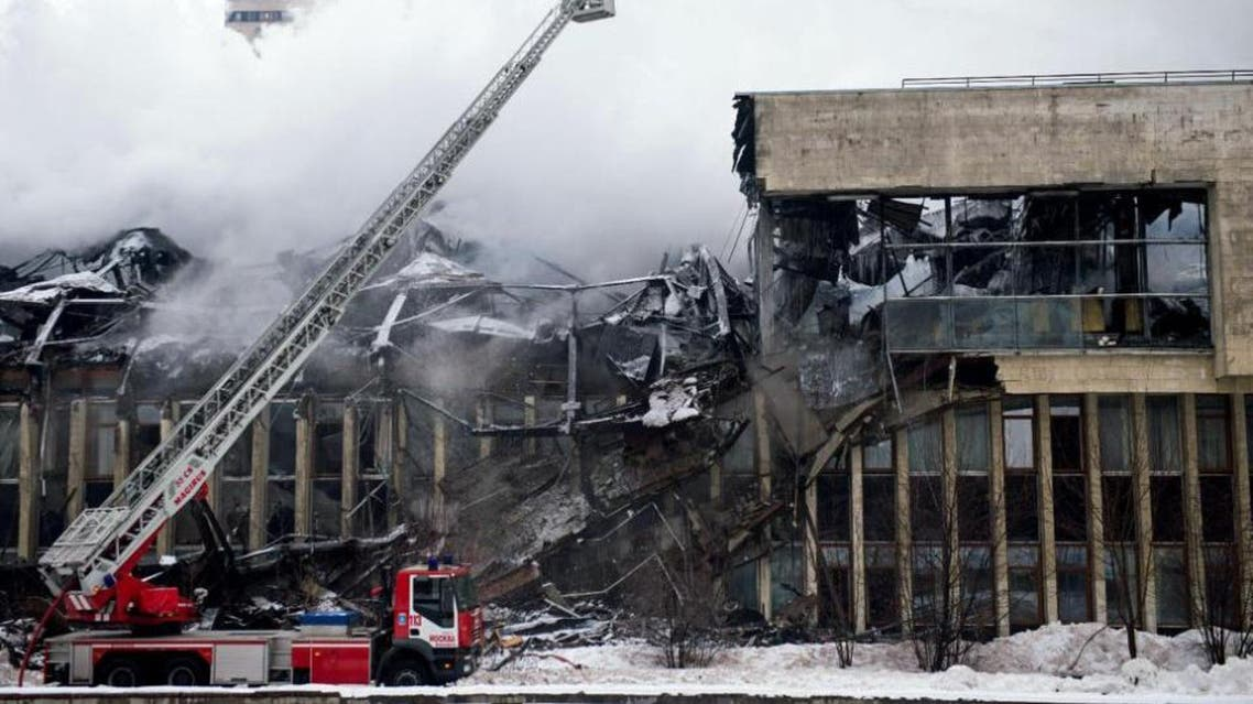 Firefighters work to extinguish a blaze at the library of the Academic Institute of Scientific Information on Social Sciences in Moscow on January 31, 2015 (AFP Photo/Alexander Utkin)