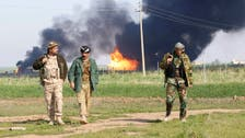 Iraq oilfield output suspended after ISIS fighting: oil minister