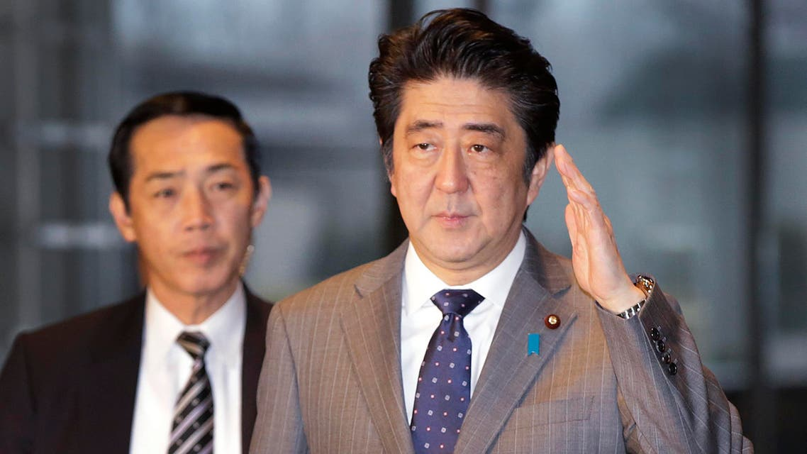 Japan's Prime Minister Shinzo Abe, right, arrives at the prime minister's official residence in Tokyo, Friday, Jan. 30, 2015. (File photo: AP)