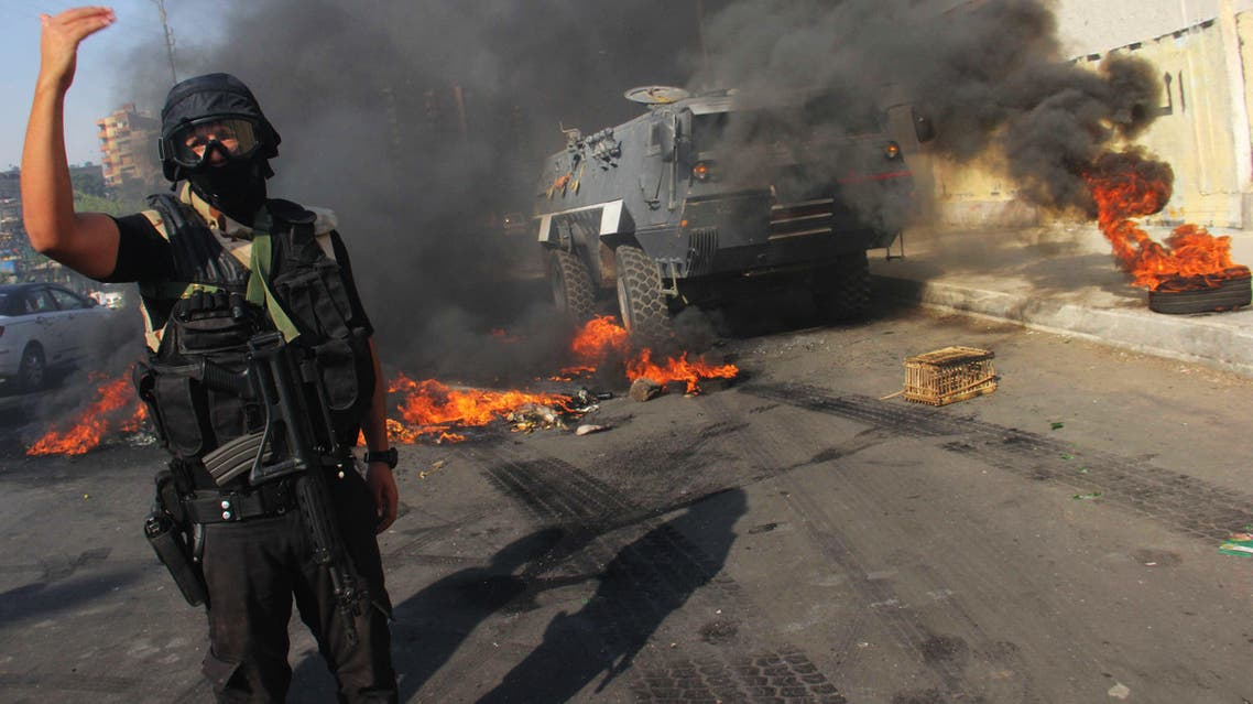 An Egyptian security forces member directs others near Suez Bridge district, Egypt, Thursday, July 3, 2014. (AP)