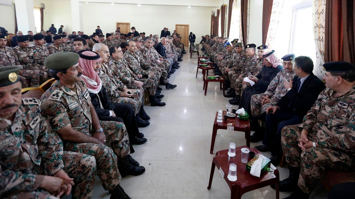 Saif al-Kasaesbeh (4th R), father of Jordanian pilot Muath al-Kasaesbeh, sits among senior officers of the Jordanian army at the headquarters of his family's clan in the city of Karak Feb. 4, 2015.  (Reuters)