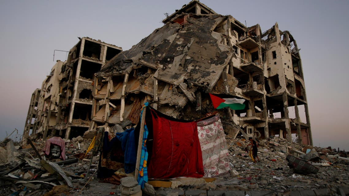 In this Aug. 7, 2014 file photo, a makeshift tent stands amid the destruction of buildings at a residential neighborhood in Beit Lahiya, northern Gaza Strip. The Israeli military said Wednesday, Sept. 10,