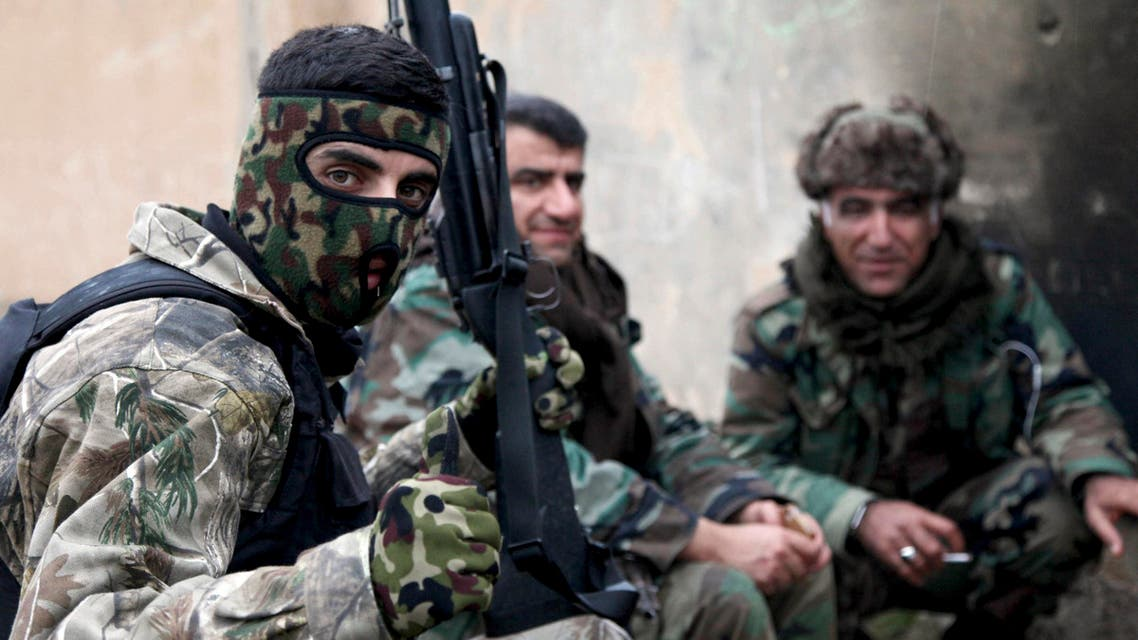 Kurdish Peshmerga fighters take a rest on the outskirts of Mosul January 30, 2015. REUTERS