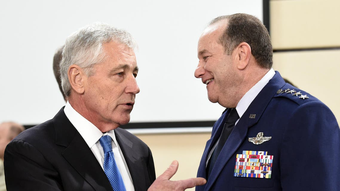 LtoR) US Defense minister Chuck Hagel talks with US General Philip Breedlove during a defence ministers meeting at the NATO headquarters in Brussels on February 5, 2015. AFP