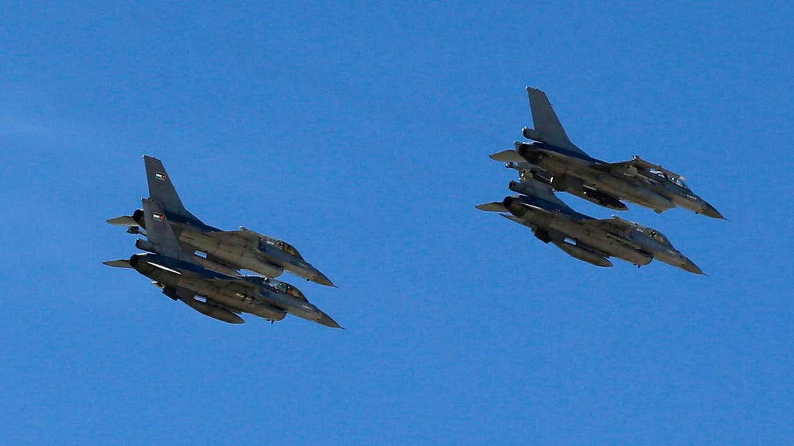 Planes belonging to the Jordanian Royal Air Force fly over the headquarters of the family clan of pilot Muath al-Kasaesbeh in the city of Karak Feb. 4, 2015. (Reuters)