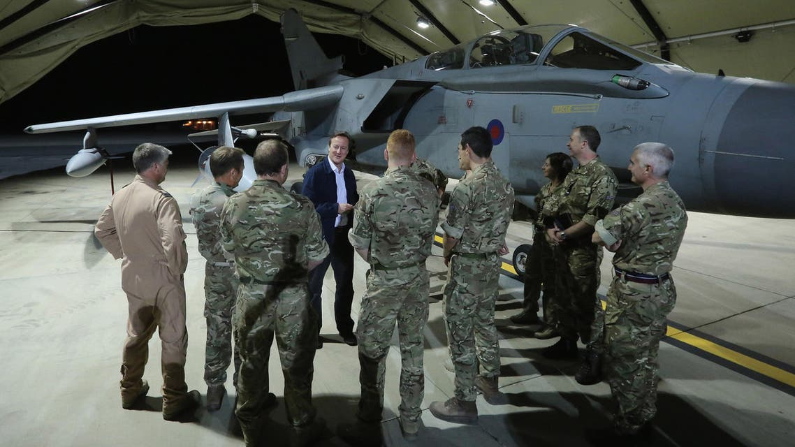 British Prime Minister David Cameron meets pilots, engineers and logistic support staff in front of a Tornado GR4 at RAF Akrotiri base, Cyprus, Thursday, Oct. 2, 2014. (Reuters)
