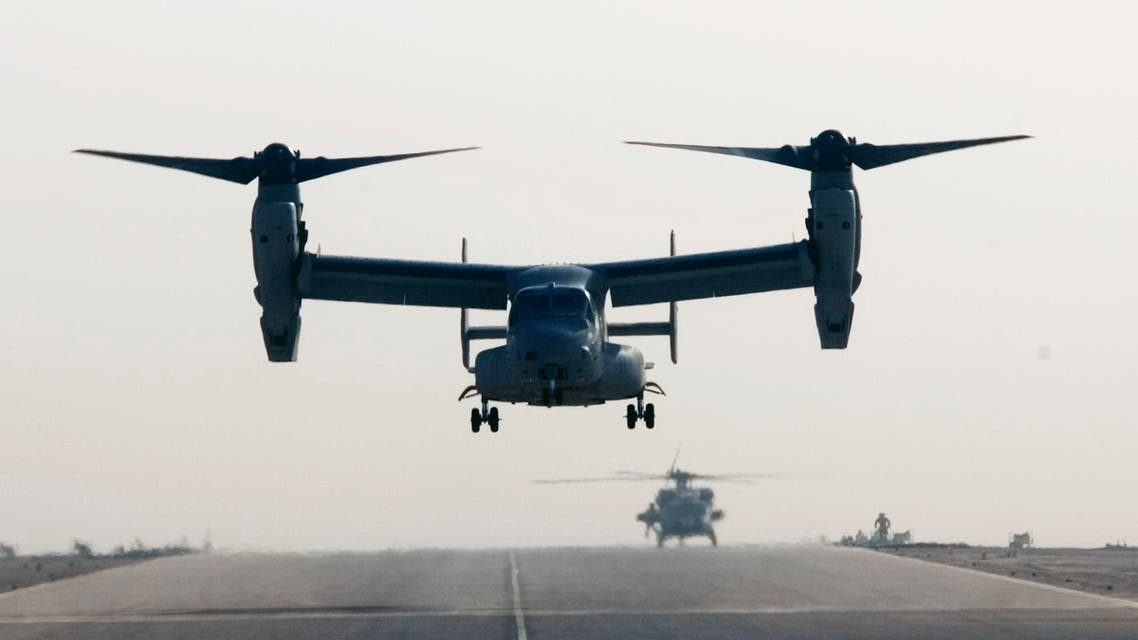 A V-22 Osprey tilt rotor aircraft lands at Asad air base after a mission in western Iraqi desert Tuesday, Oct. 14, 2008.  (AP)