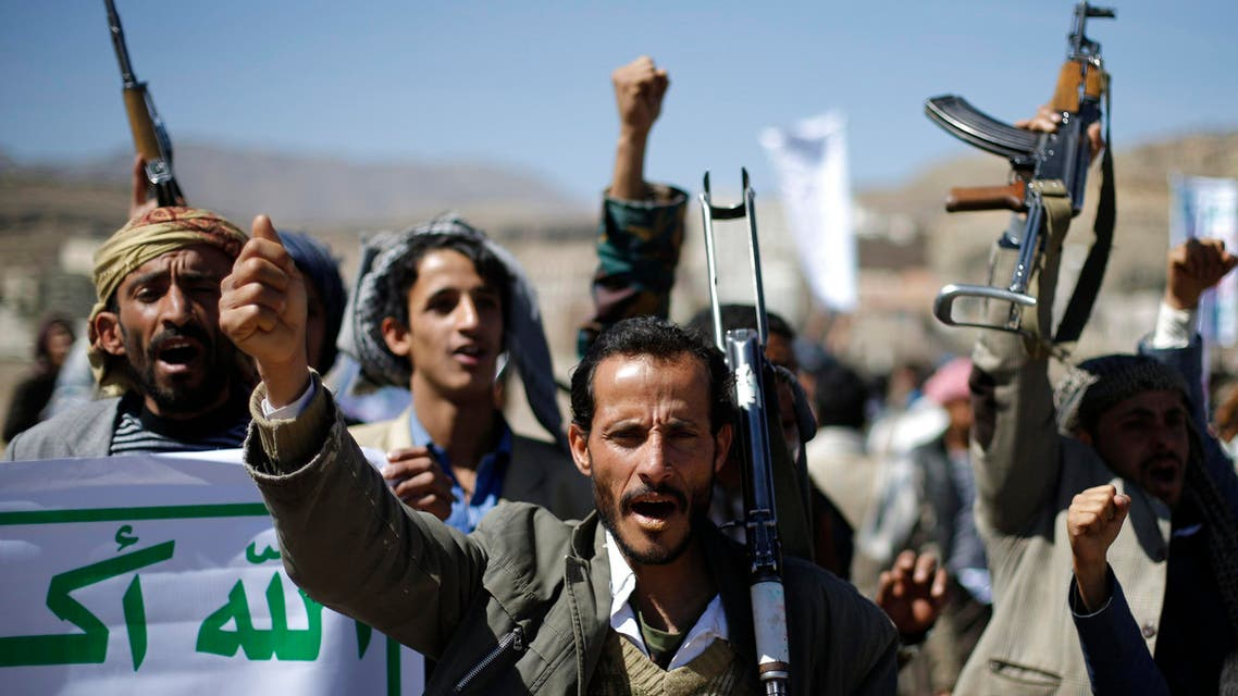 Followers of the Houthi movement shout slogans during a gathering to show support to the movement outside the Presidential Palace in Sanaa February 4, 2015. (Reuters)