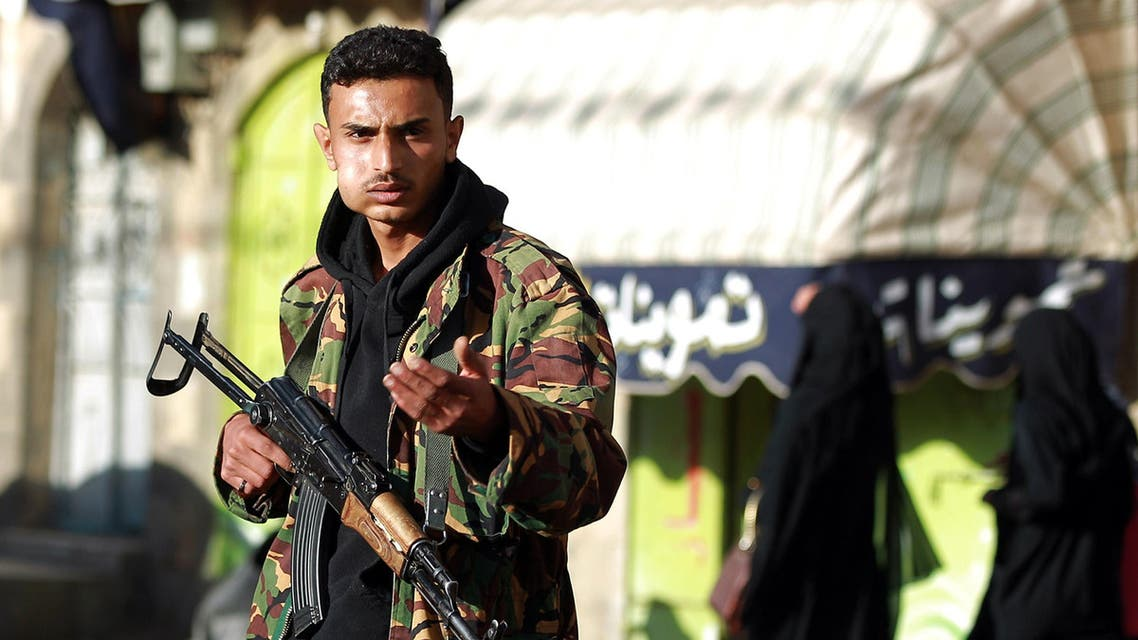 A Yemeni armed member of the Shiite Huthi movement in an army uniform guards a checkpoint on a street leading to the presidential palace in the capital Sanaa on Feb. 6, 2015.  (AFP)