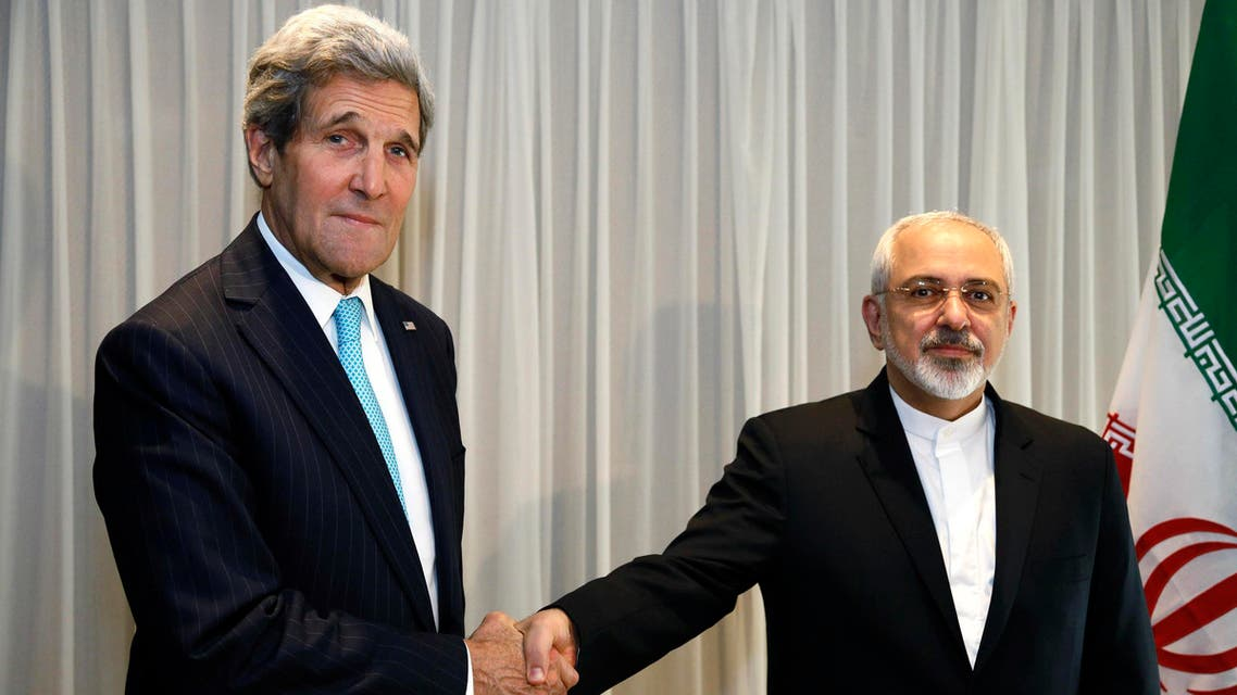 U.S. Secretary of State John Kerry shakes hands with Iranian Foreign Minister Mohammad Javad Zarif before a meeting in Geneva January 14, 2015. (Reuters)