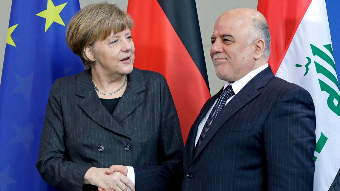 German Chancellor Angela Merkel, left, and the Prime Minister of Iraq, Haider al-Abadi, right, shake hands after a joint news conference as part of a meeting at the chancellery in Berlin, Germany, Friday, Feb. 6, 2015. (AP Photo/Michael Sohn)