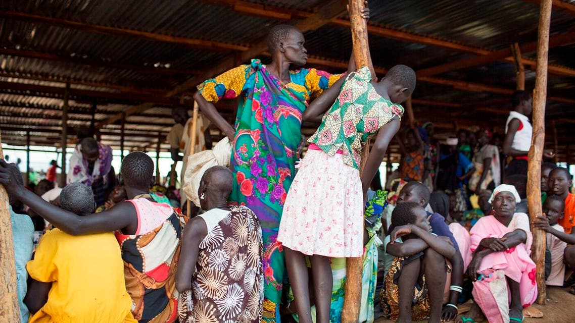 Internally displaced South Sudanese wait under a shelter for the food to be distributed in Minkaman, South Sudan , Thursday, June 26, 2014. (AP)