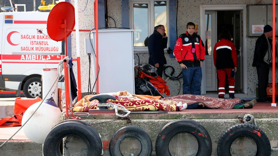 Dead bodies covered with blankets lie on the ground after a boat carrying suspected migrants from Afghanistan and Syria sank just north of the Bosphorus Strait off the coast of Istanbul, Turkey, Monday, Nov. 3, 2014, leaving at least 24 people dead and several people missing. Seven people were rescued, Turkish authorities said.(AP Photo)