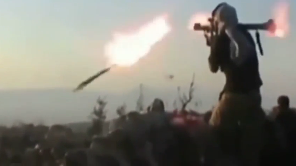 In this clip, uploaded on video-sharing site YouTube, an ISIS fighter firing an RPG discovers that the missile falls far short of the target (Still courtesy of YouTube)