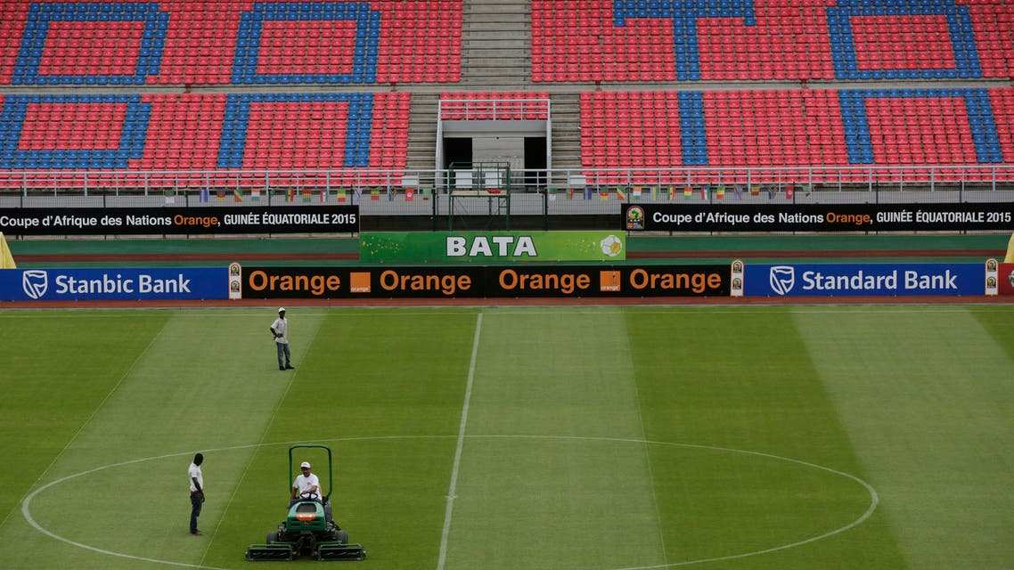 Stadium workers level the grass ahead of the African Cup of Nations final soccer match between Ivory Coast and Ghana on Sunday, at Estadio De Bata, Equatorial Guinea, Saturday Feb. 7, 2015. (AP)