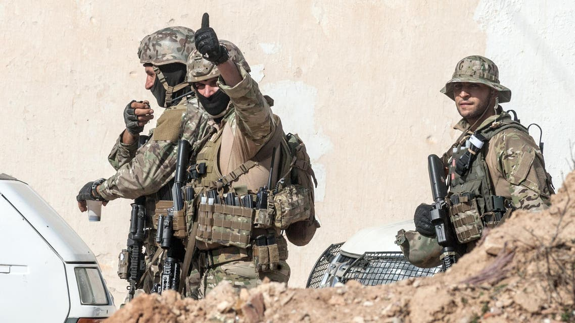 A Tunisian soldier gives a thumbs up to celebrate the end of a raid against gunmen in the Oued Ellil suburb of Tunis, Tunisia, Friday, Oct. 24, 2014. (File photo: AP)