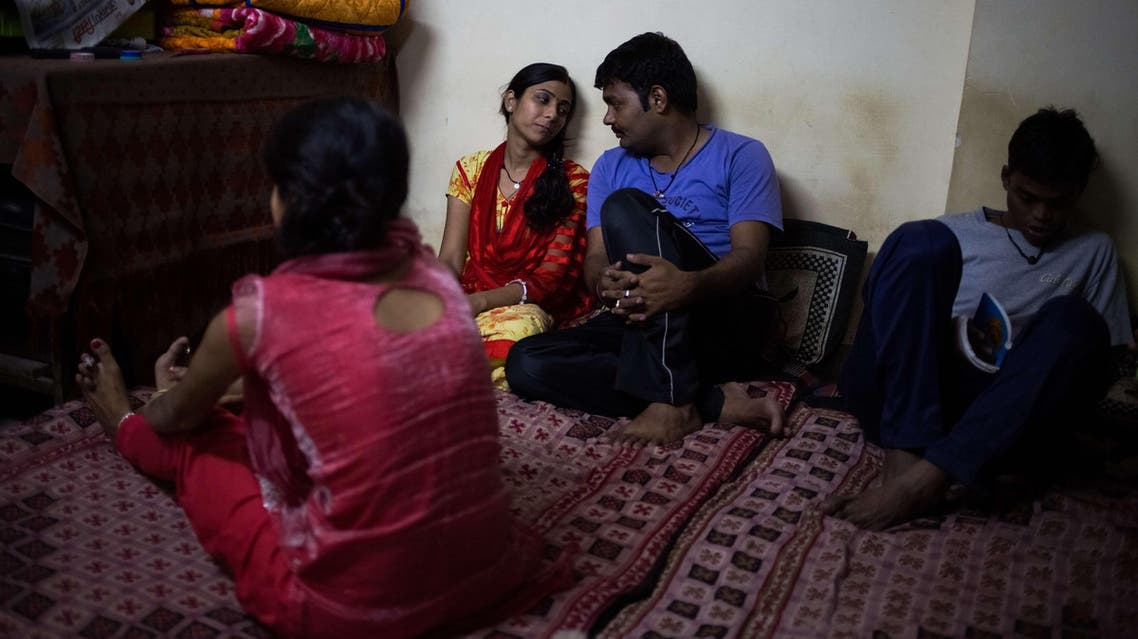 Indian couple Deepika (2L), 24, and Vibhor (2R), 24, and who left their homes to marry against their parents' wishes, talk with another resident at one of seven shelters for couples who have left home to have 'love marriages' run by the Love Commandos NGO in New Delhi on October 19, 2014. (AFP)
