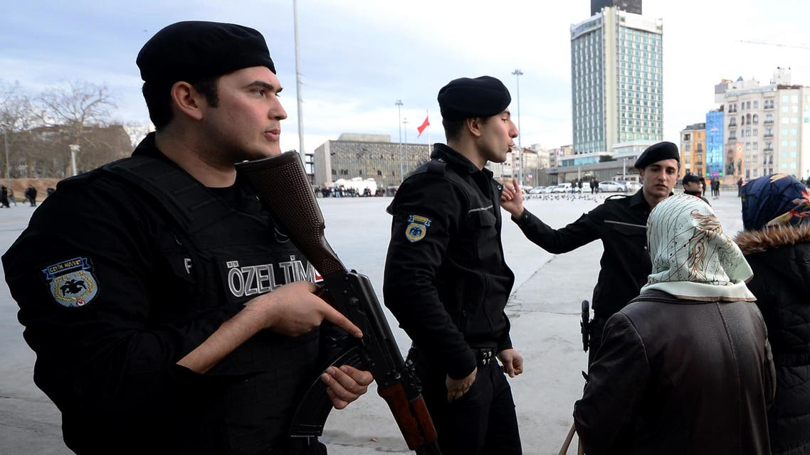 Police officers ask people to stay away at the main Taksim Square in Istanbul, Turkey, Friday, Jan. 30, 2015, after a woman opened automatic weapon fire at a police vehicle in Taksim, before escaping on foot.  (AP)