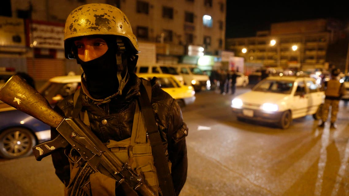 A member of Iraq's security forces stands guard at Tahrir Square in Baghdad February 8, 2015. (Reuters)