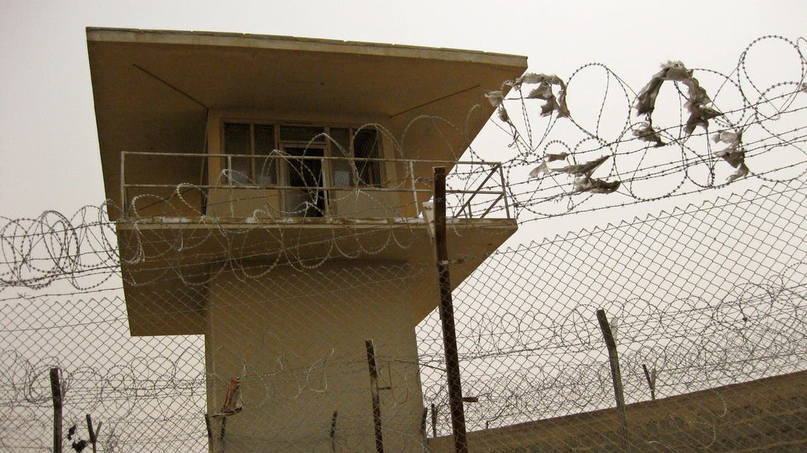 This Saturday, July 24, 2010 photo shows a guard tower and fences with barbed wire for a U.S.-funded prison in Khan Bani Saad, Iraq, northeast of Baghdad. (File photo: AP)