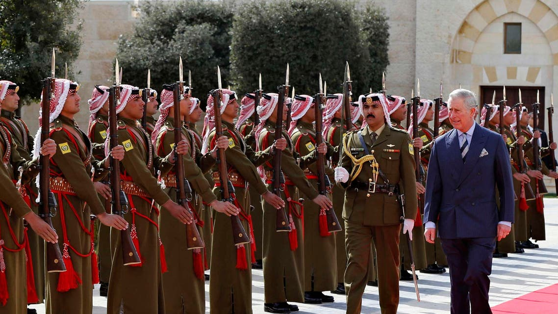 Britain's Prince Charles (R) reviews an honour guard before a meeting with Jordan's King Abdullah at the Royal Palace in Amman February 8, 2015.  (Reuters)