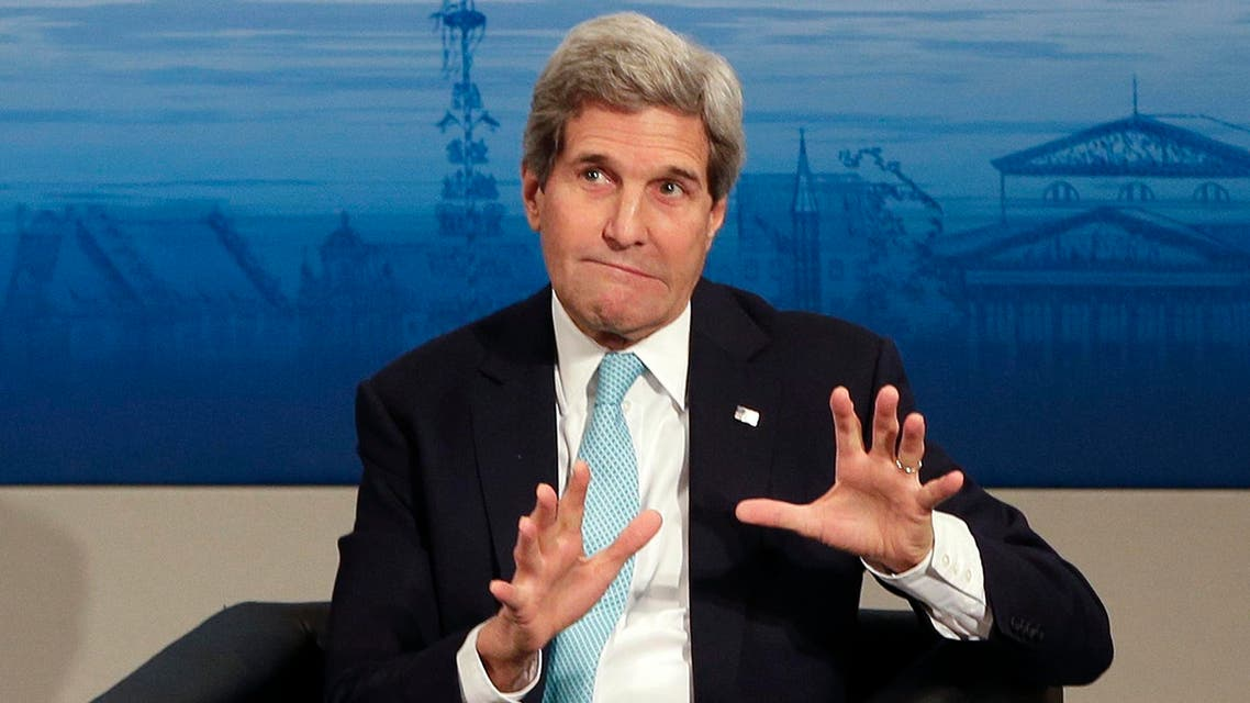 U.S. Secretary of State John Kerry gestures as he takes place on the podium during the 51. Security Conference in Munich, Germany, Sunday, Feb. 8, 2015. (AP)