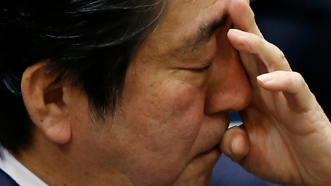 Japan's Prime Minister Shinzo Abe scratches his face during an upper house committee session at the parliament in Tokyo February 2, 2015. (Reuters)