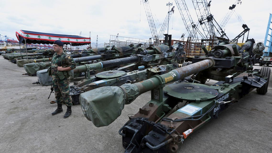 A Lebanese army soldier stands next to artillery pieces that were unloaded from a ship at Beirut's port in Lebanon on Sunday, Feb. 8, 2015. (AP)
